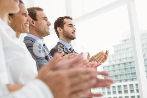 Business people clapping hands in office
