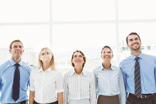 Business people looking up in office