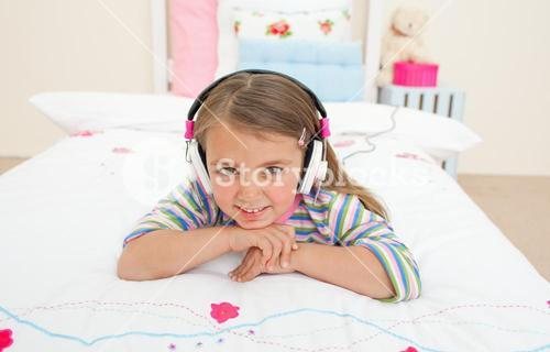 Cute little gril listening to music