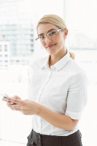 Businesswoman text messaging in office