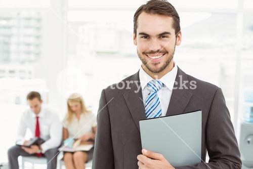 Businessman against people waiting for interview