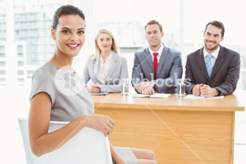 Woman in front of corporate personnel officers