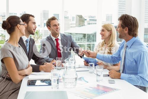 Young business people in board room meeting