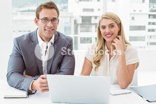 Business people with laptop at office