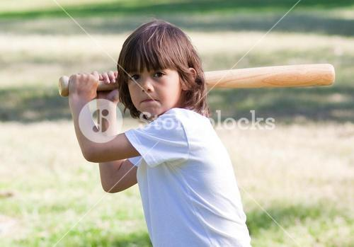 Close up of adorable child playing baseball