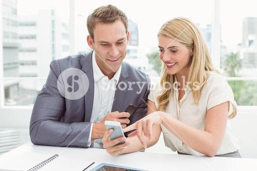 Business people using mobile phone