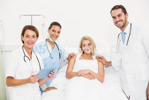 Portrait of doctors visiting patient