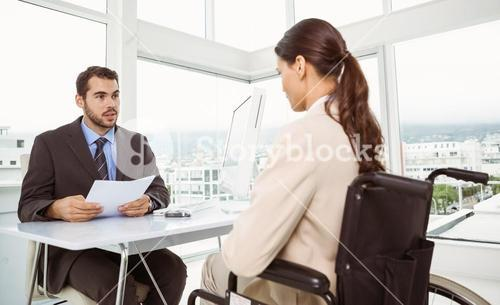 Businessman interviewing woman in office