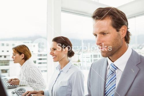 Business people using computers in office