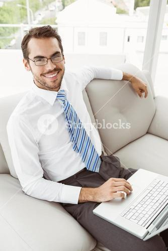 Businessman using laptop in living room