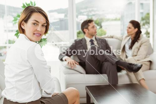 Couple in meeting with financial adviser at home