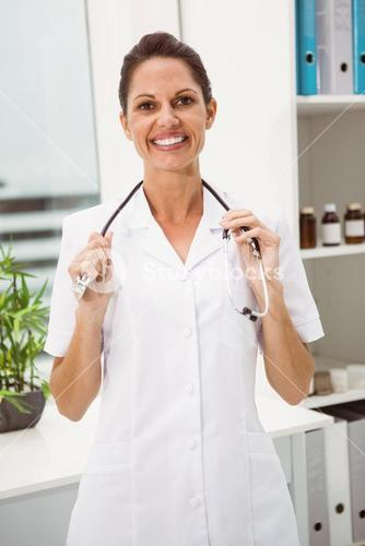 Female doctor with stethoscope at medical office