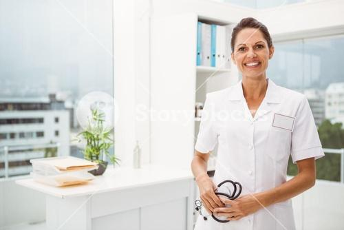 Smiling female doctor with stethoscope at medical office