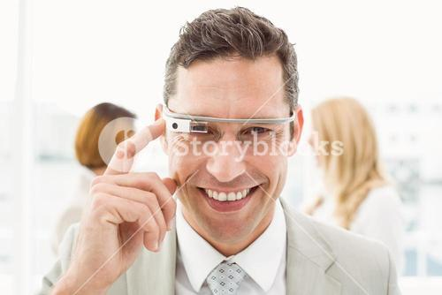 Man smiling with Google glasses