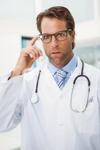 Serious doctor using Google glasses
