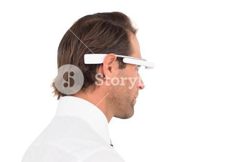 Handsome businessman using google glass