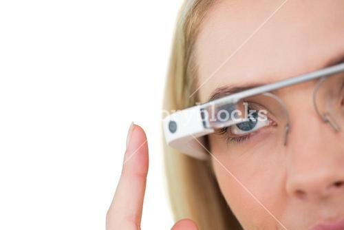 Blonde businesswoman using google glass