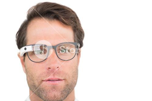 Focused businessman using google glass