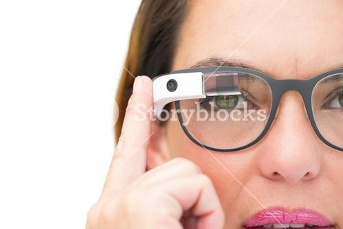 Serious businesswoman using google glass