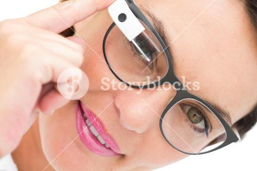 Smiling businesswoman using google glass