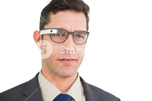 Serious businessman using google glass