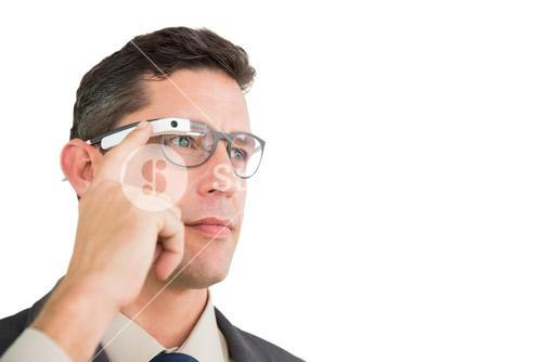 Smiling businessman using google glass