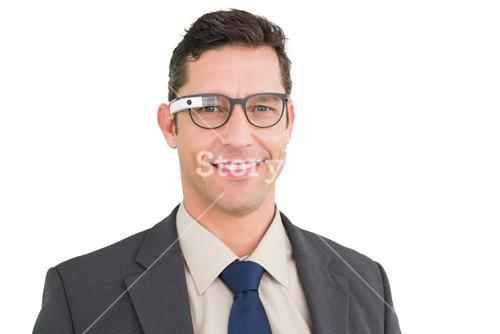 Happy businessman using google glass