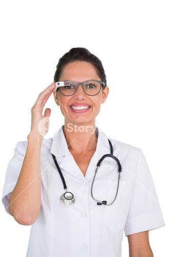 Smiling nurse using google glass