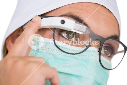 Nurse wearing surgical mask using google glass