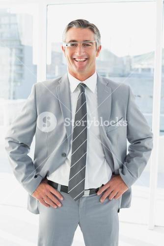 Smiling businessman with Google glasses