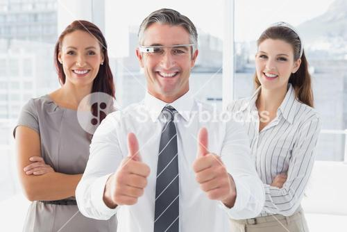 Businessman using Google glasses with team