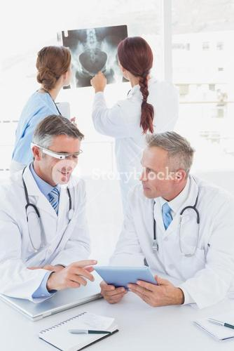 Doctor with Google glasses talking