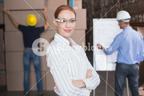 Businesswoman working with Google glasses