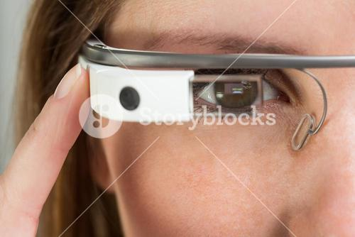 Young businesswoman using google glass