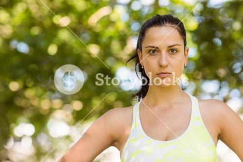 Focused athletic brunette in the park
