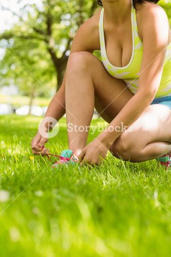 Athletic  woman tying her shoelace