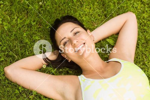 Relaxed fit brown hair lying on grass