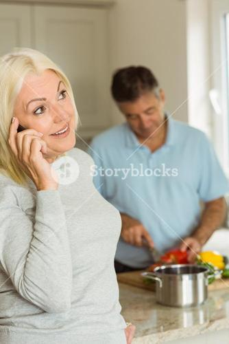 Happy mature blonde on the phone