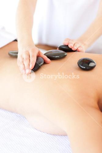 Woman having a stone therapy
