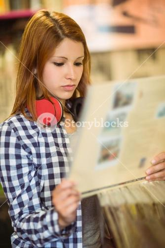 Redhead with check shirt holding a vinyl