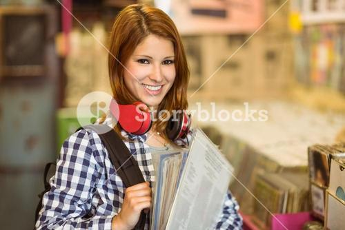 Smiling girl holding some vinyls