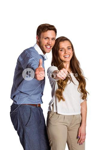 Happy couple gesturing thumbs up