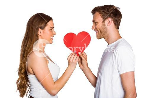 Romantic young couple holding heart