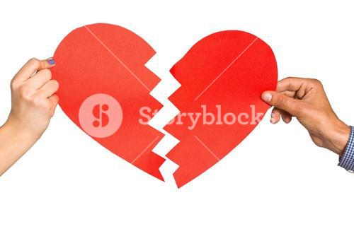 Two hands holding broken heart
