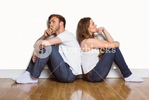Side view of couple sitting on floor