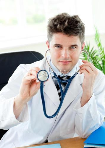 Smiling doctor with a stethoscope isolated