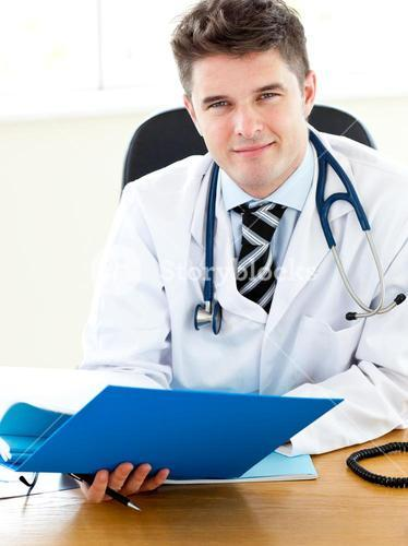 Selfassured doctor reading a report