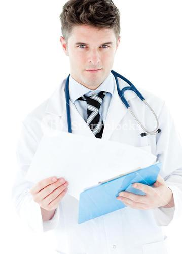 Portrait of a charming male doctor holding a stethoscope against a white background