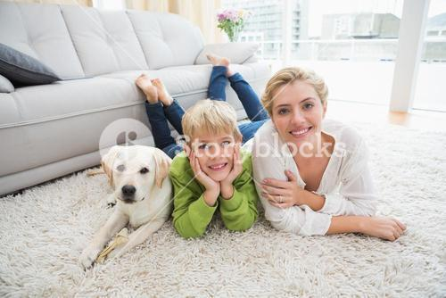 Happy mother and son with puppy