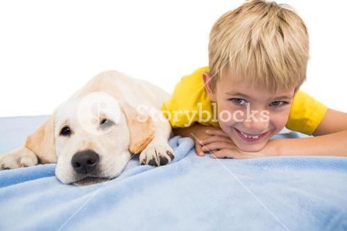 Happy little boy with puppy